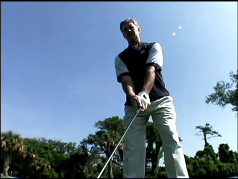man playing golf - golf swing on white stock videos & royalty-free footage