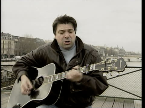 man playing guitar and singing euro song cms ditto - plucking an instrument stock videos and b-roll footage