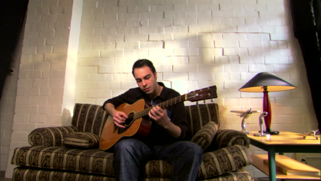 man playing guitar at home - see other clips from this shoot 1429 stock videos & royalty-free footage