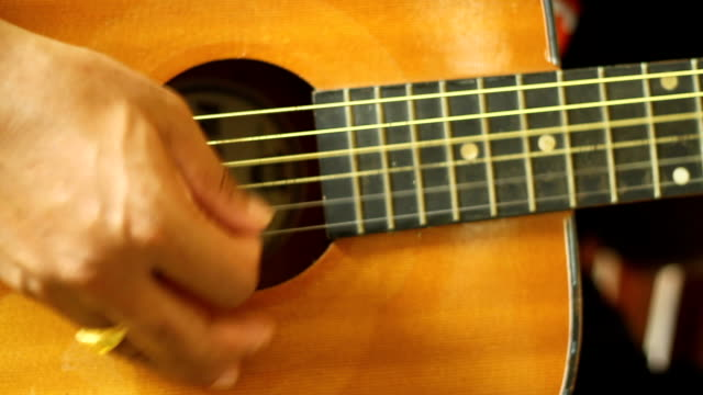 man playing guitar close up - plucking an instrument stock videos and b-roll footage