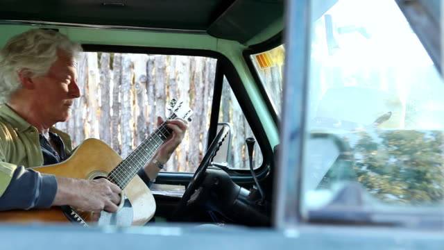 ms pan man playing guitar in his pickup truck / lamy, new mexico, united states - lamy new mexico stock videos & royalty-free footage