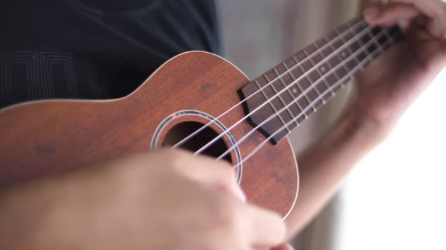 man playing guitar - fretboard stock videos & royalty-free footage