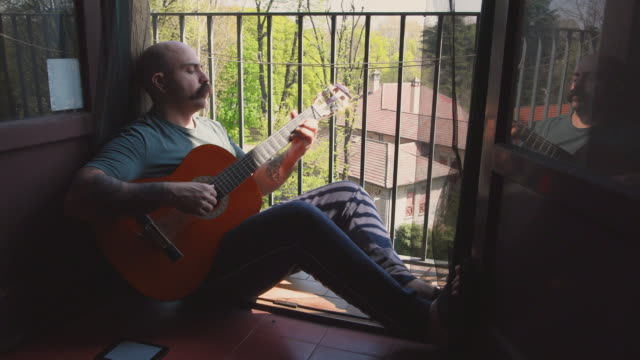 man playing guitar - mid adult men video stock e b–roll