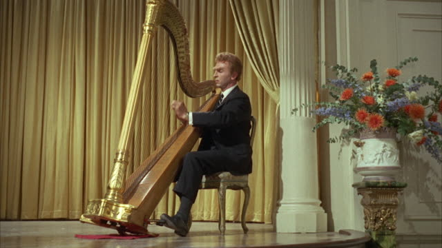 1966 ws man playing harp on stage - harp stock videos & royalty-free footage