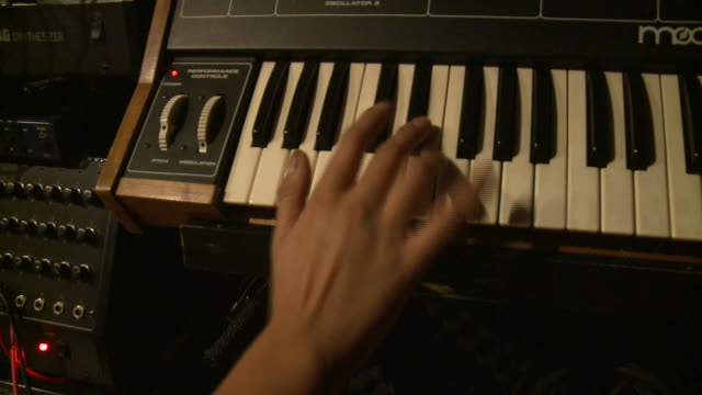 cu man playing on  keyboard in recording studio, gent, belgium - synthesizer stock videos & royalty-free footage