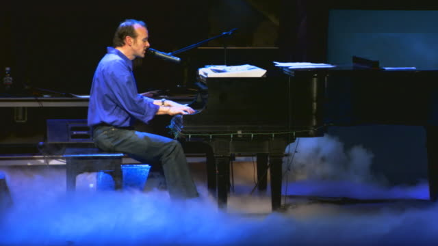 man playing piano at concert - dry ice stock videos & royalty-free footage
