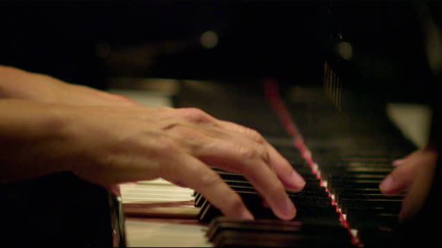 cu selective focus man playing piano / salt lake city, utah, usa - ピアノ点の映像素材/bロール