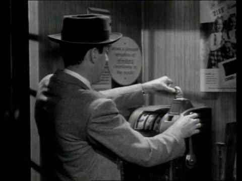 1948 MONTAGE Man playing slot machine and getting lemons /