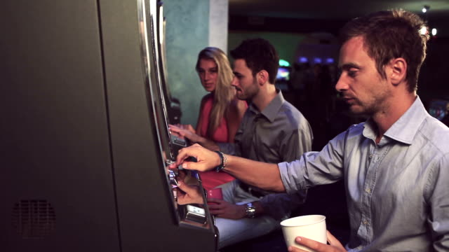 man playing slot machine at casino - machinery stock videos and b-roll footage