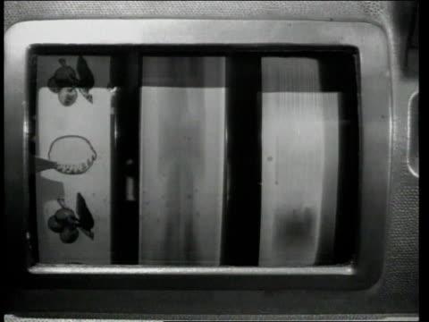 1948 montage man playing slot machine / united states - fruit machine stock videos & royalty-free footage