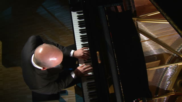 hd crane: man playing the grand piano - concert hall stock videos and b-roll footage