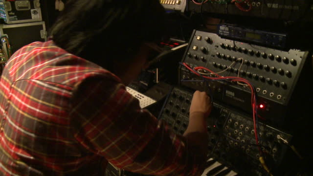 ms man playing various keyboards in recording studio, gent, belgium - synthesizer stock videos & royalty-free footage