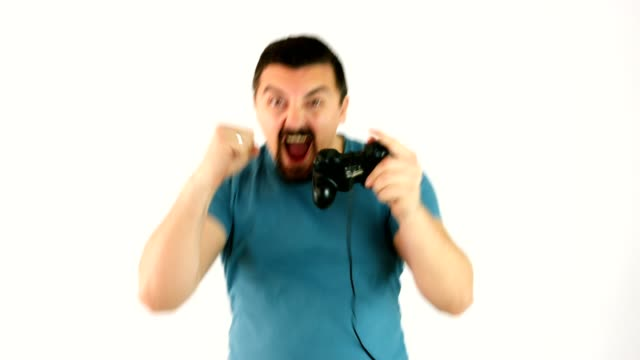 man playing video games with a gamepad or joystick happy for winning the game - gamepad stock videos & royalty-free footage