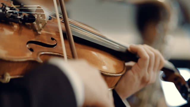 man playing violin at a concert - musical theater stock videos and b-roll footage