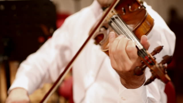 man playing violin at concert - musical instrument bridge stock videos & royalty-free footage