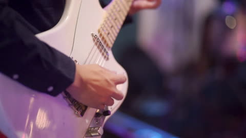 man playing white guitar on stage - live event stock videos & royalty-free footage