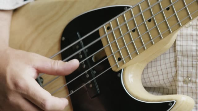 a man plays a bass guitar - number 5 stock videos & royalty-free footage