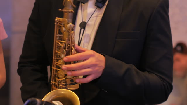 a man plays a saxophone - saxophone stock videos and b-roll footage
