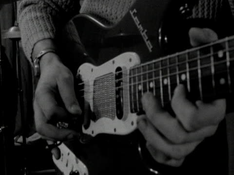 a man plays an electric guitar - plucking an instrument stock videos and b-roll footage