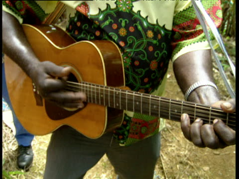 man plays guitar and sings in banana plantation windward islands - menschliche gliedmaßen stock-videos und b-roll-filmmaterial