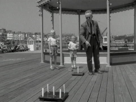 a man plays hoopla on bournemouth pier - bournemouth england stock videos & royalty-free footage