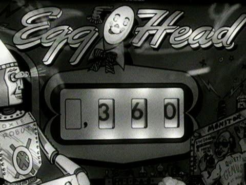 a man plays on a pinball machine in an amusement arcade - pinball machine stock videos & royalty-free footage