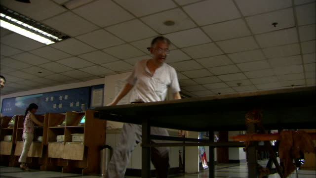 a man plays ping pong, china. available in hd. - table tennis stock videos and b-roll footage