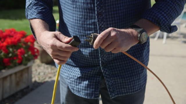 Man plugs extension cord