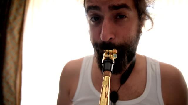 Man plying saxophone