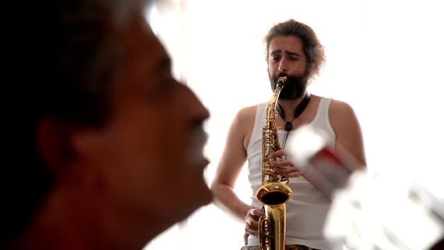 man plying saxophone - saxophone stock videos & royalty-free footage