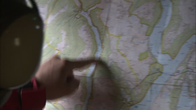 a man points at locations on a map. - pointing stock videos & royalty-free footage