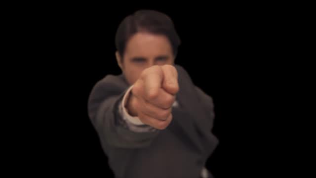 ms man points directly at camera - 背広点の映像素材/bロール