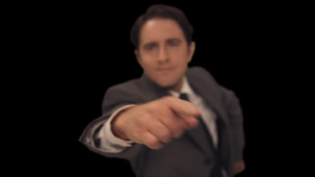ms man points forward � to camera - 背広点の映像素材/bロール