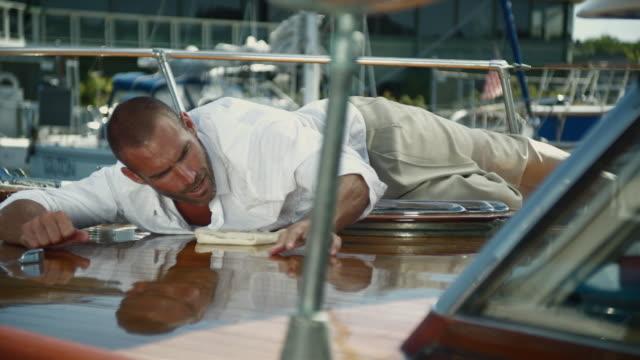 MS Man polishing boat / Seattle, Washington, USA