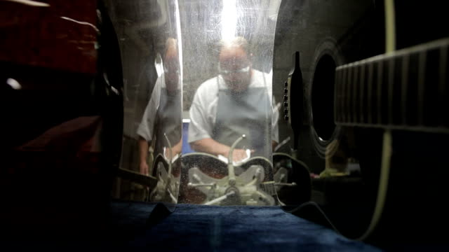 cu man polishing exterior of guitar shell  / nazareth, pennsylvania, usa - country and western stock videos & royalty-free footage