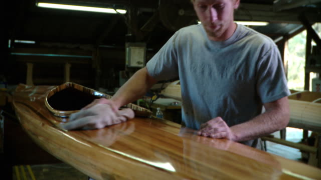ms man polishing wooden kayak in workshop, live oak, florida, usa - craftsman stock videos and b-roll footage