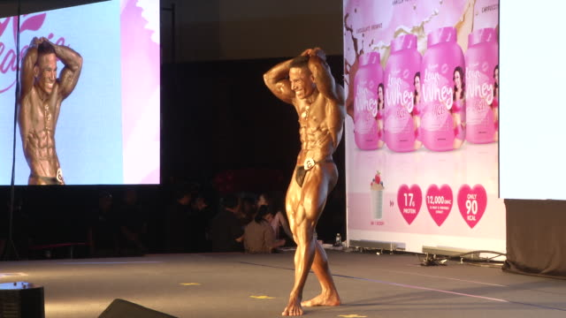 a man pose during the fit angel classic bodybuilding competition in bangkok thailand - body building stock videos & royalty-free footage