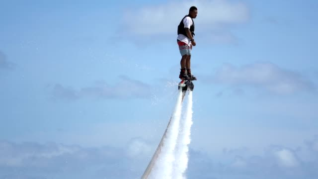 man posing at water extreme sport flyboard. - fountain stock videos & royalty-free footage