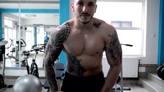 man posing in the gym. slow motion. - semi dress stock videos & royalty-free footage