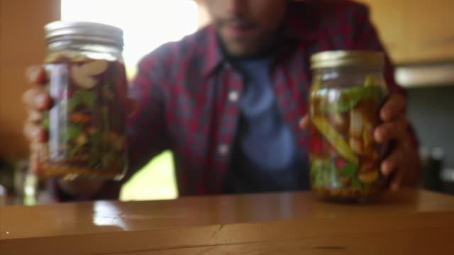 ms man positioning jars on shelf, bovina center, new york, usa - jar stock videos & royalty-free footage