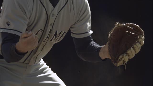 CU Man pounding baseball glove / Thousand Oaks, California, USA