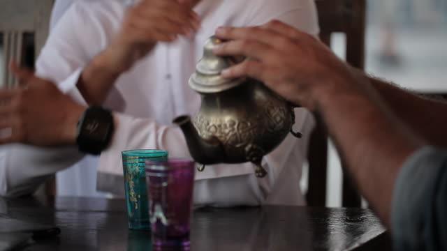 CU man pouring tea/Dubai/UAE