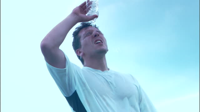 Man pouring water bottle