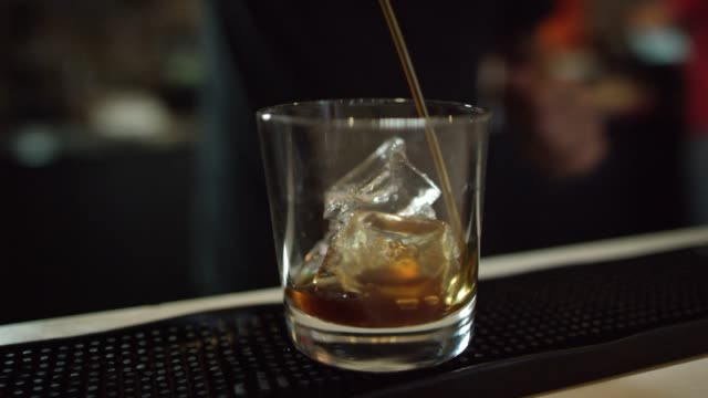 a man pours a drink - bartender stock videos and b-roll footage