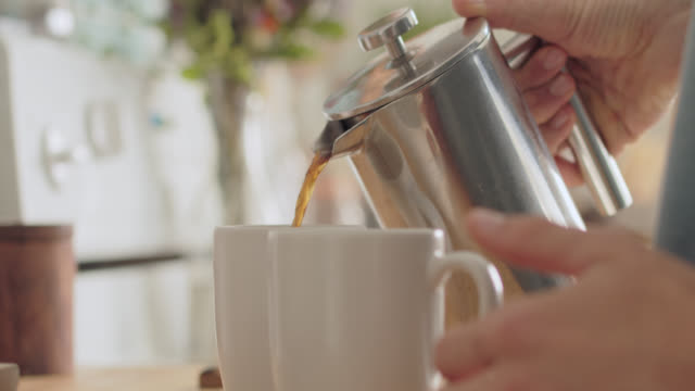 cu man pours cream and coffee into two coffee cups - coffee cup stock videos & royalty-free footage