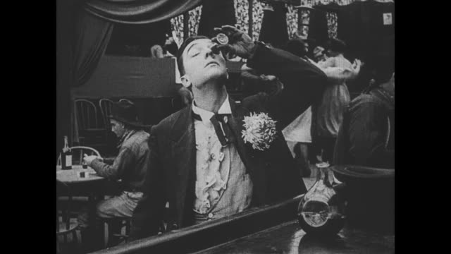 1918 man (buster keaton) pours shots of alcohol into his eyes - buster keaton stock videos and b-roll footage