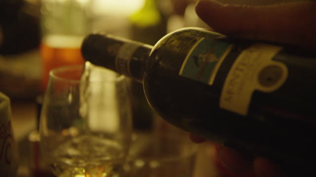 a man pours wine into a glass - italien stock-videos und b-roll-filmmaterial