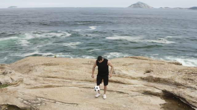 ws, ts a man practices his football skills on ipanema beach - soccer player stock videos and b-roll footage