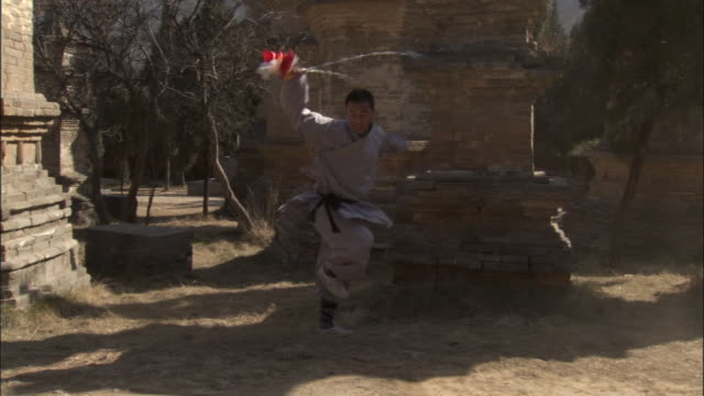 man practices kung fu moves with metal chains, beijing, china - martial arts stock videos & royalty-free footage