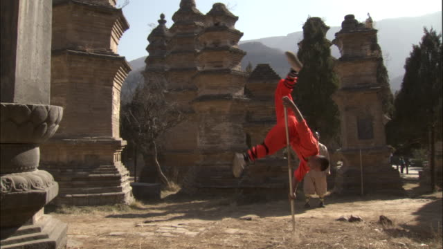 man practices kung fu moves with metal pole, beijing, china - balance stock videos & royalty-free footage